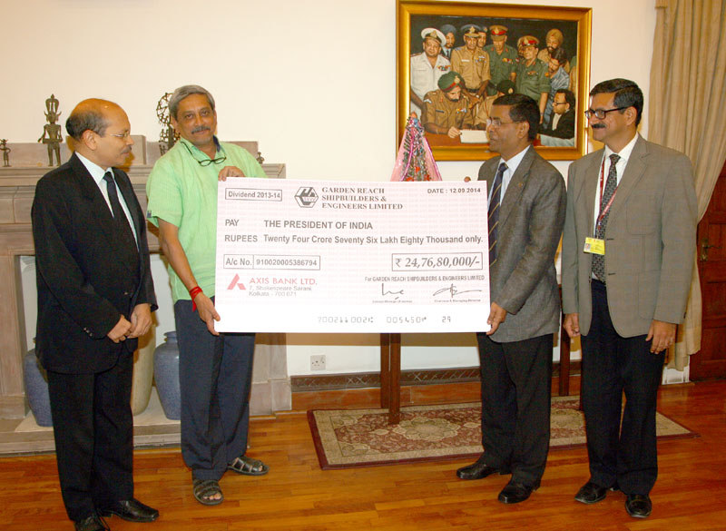The Union Minister for Defence, Shri Manohar Parrikar receiving a dividend cheque of..