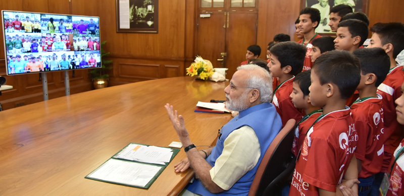 The Prime Minister, Shri Narendra Modi interacting with the children at the launch of the Reliance Foundation Youth Sports, through video conferencing, in New Delhi