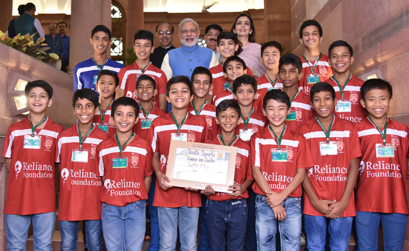 The Prime Minister, Shri Narendra Modi in a group photograph with the children,..