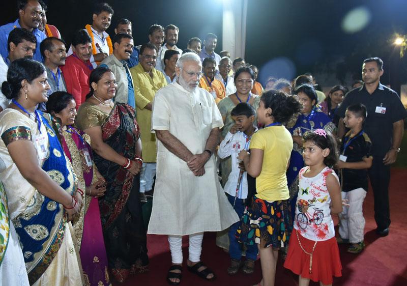 The Prime Minister, Shri Narendra Modi interacting with the children,..