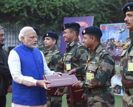 The Prime Minister, Shri Narendra Modi presents certificates to ..