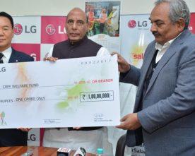 The Union Home Minister, Shri Rajnath Singh receiving a cheque of ..