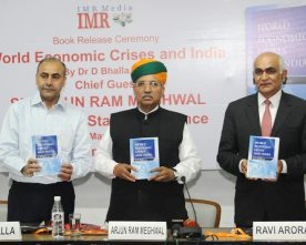 Dr. D. Bhalla, IAS, releasing the book World Economic Crises and India..