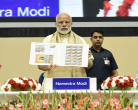 The Prime Minister, Shri Narendra Modi releasing the Special Commemorative..