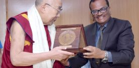 His Holiness the Dalai Lama being presented a memento by the ..