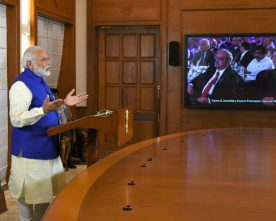 The Prime Minister, Shri Narendra Modi addressing the International..