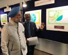 Hardeep S Puri inaugurates award winning paintings by underpriveleged childrens